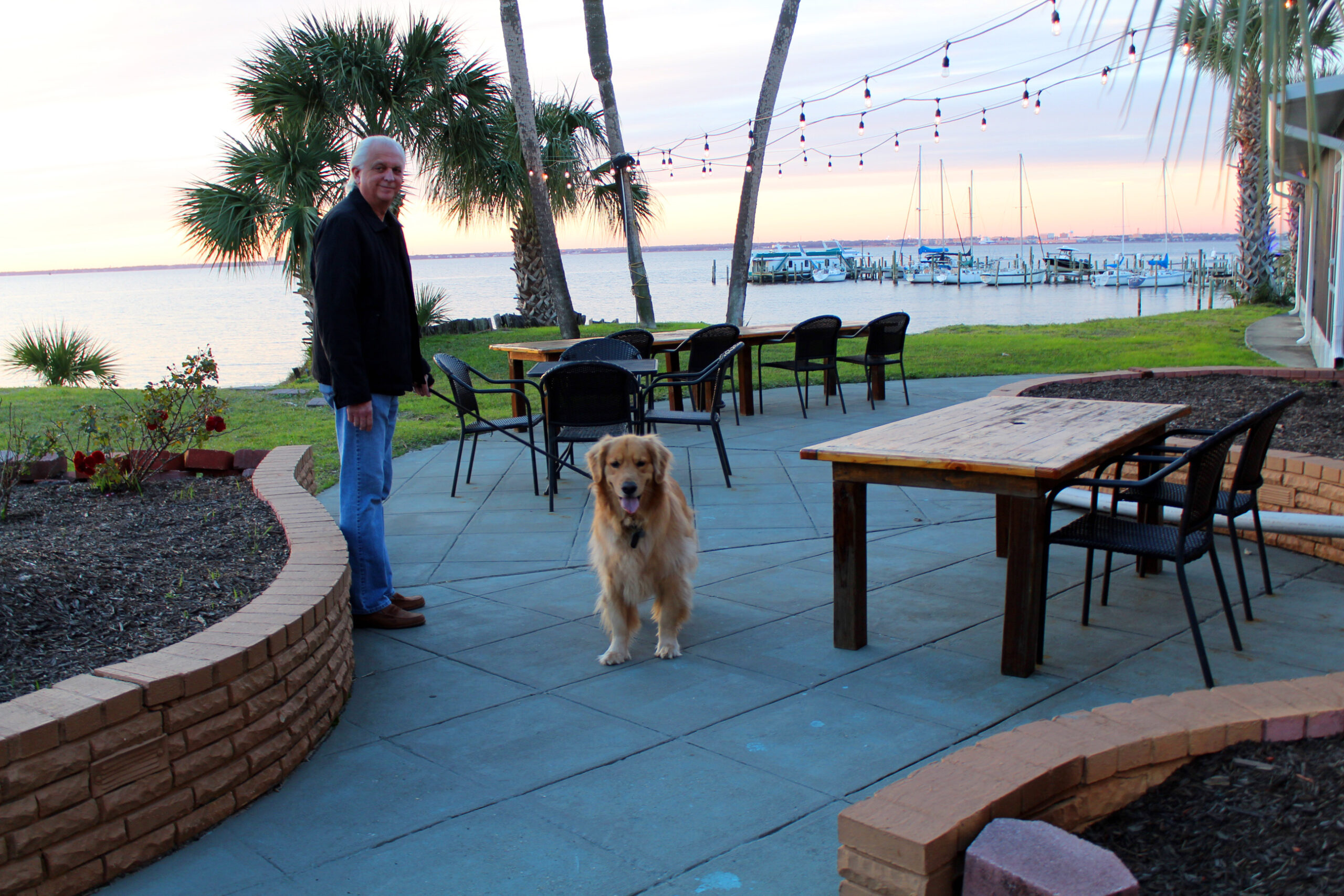 Quality Inn at Gulf Breeze FL with a stunning sunset view of the bay and harbor